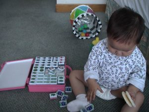 She plays her own version of Mah Jong.