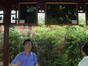 Dr. Qu and his photographs.