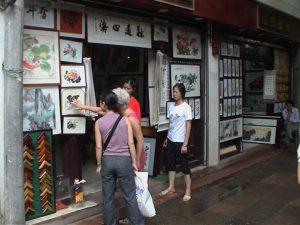 Shopping for art on Wen De Lu street.
