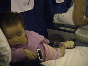 Sacked out on the plane in Premium Economy seats.